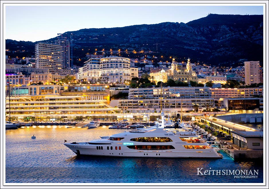 The 190 foot luxury yacht Skyfall is part of the elegance of Monte Carlo harbor at night.