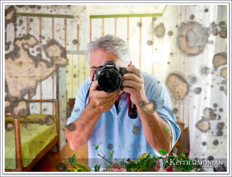 A tourist takes a photo of himself in a mirror in the childhood home of Napoleon in Ajaccio,France