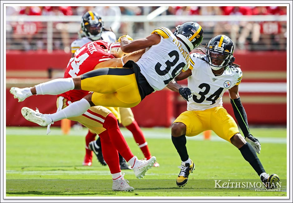 Pittsburgh Steeler #39 Minkah Fitzpatrick leaps by San Francisco 49ers fullback #44 Kyle Juszczyk at Levi's Stadium - September 22, 2019