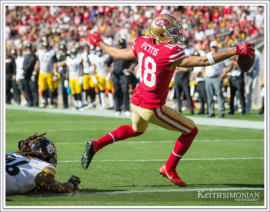 San Francisco 49er #18 Dante Pettis puts the ball across the goal line for the game winning touchdown against the Pittsburgh Steelers on September 22, 2019 at Levi's Stadium in Santa Clara, CA.