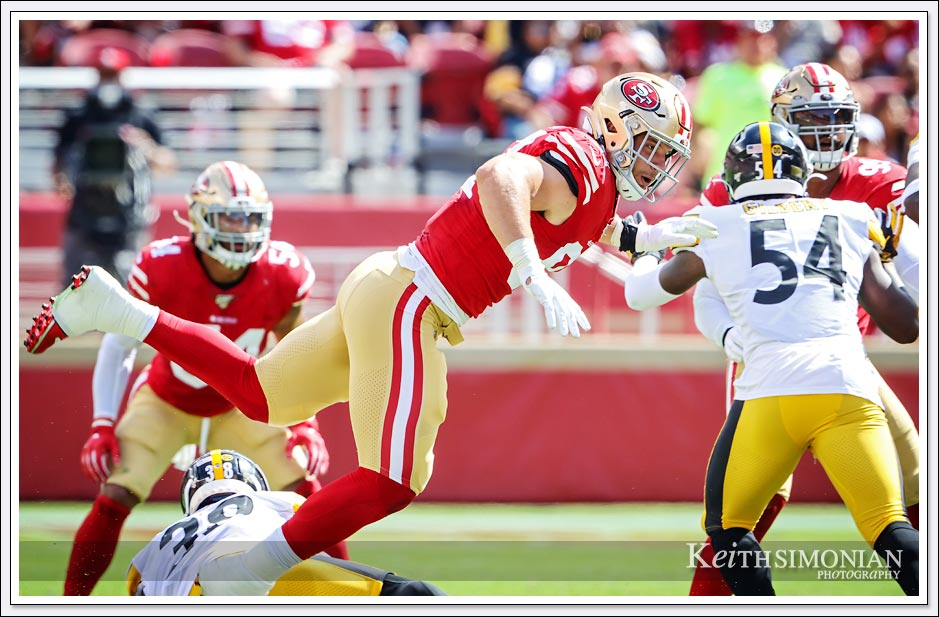 San Francisco 49er #97 Nick Bosa lunges through the air during a game against the Pittsburgh Steelers on September 22, 2019 at Levi's stadium.