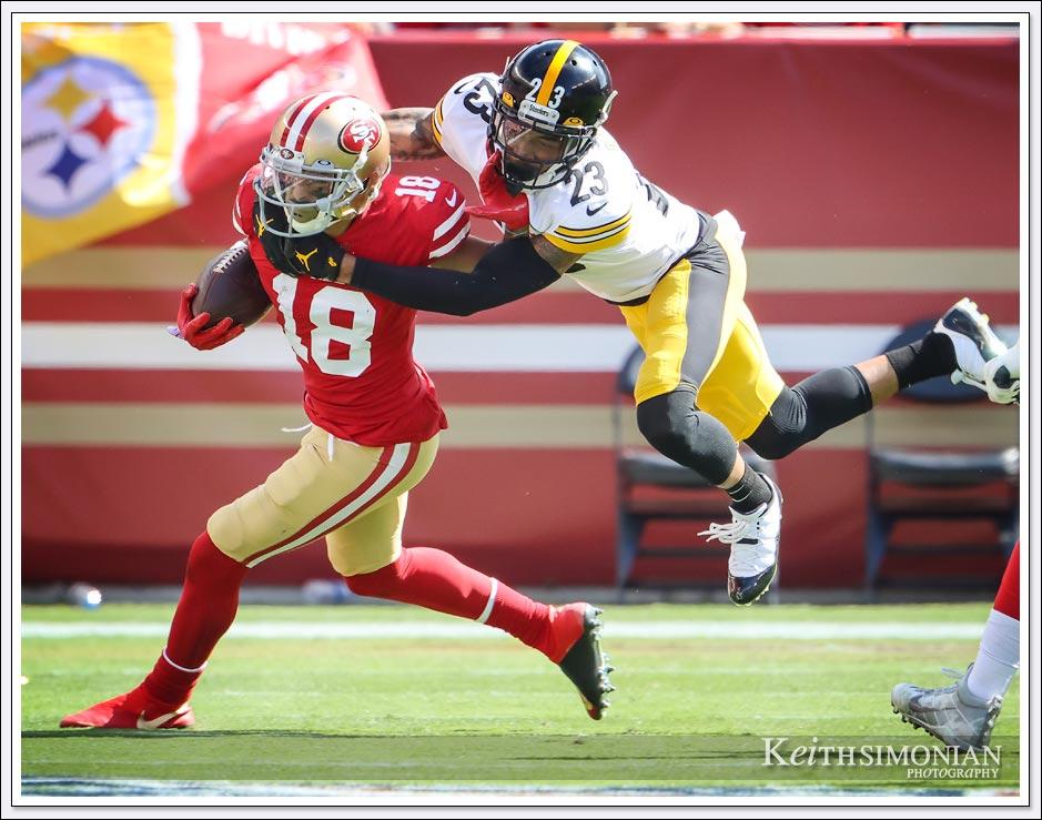Pittsburgh Steeler #23 Joe Haden attempts to tackle San Francisco 49er wide receiver #18 Dante Pettis.