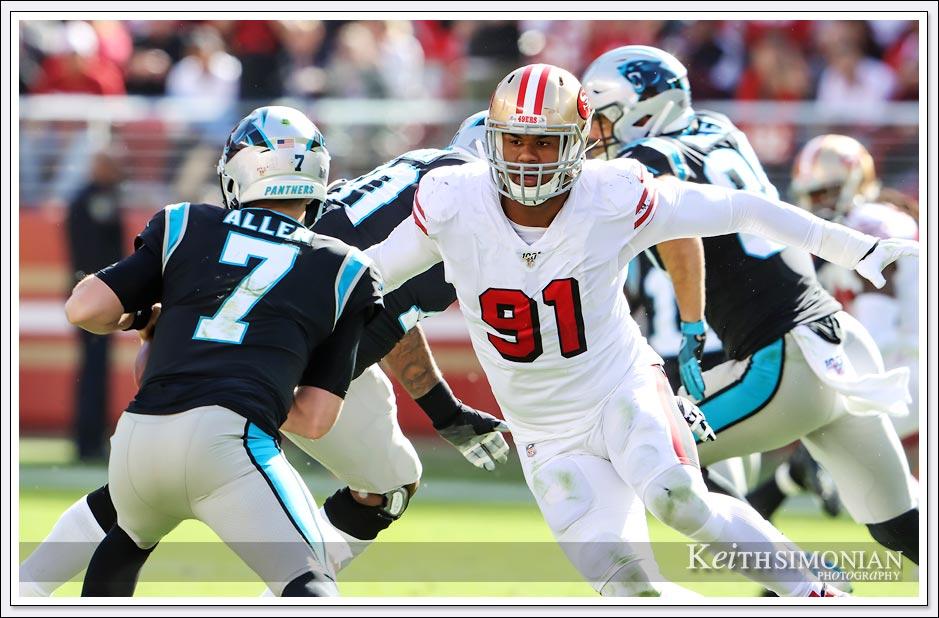 San Francisco 49er #91 Arik Armstead closes in on Carolina quarterback Kyle Allen