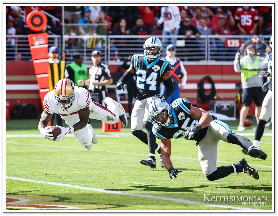 San Francisco 49er #26 Tevin Coleman scores one of his three touchdowns against the Carolina Panthers.