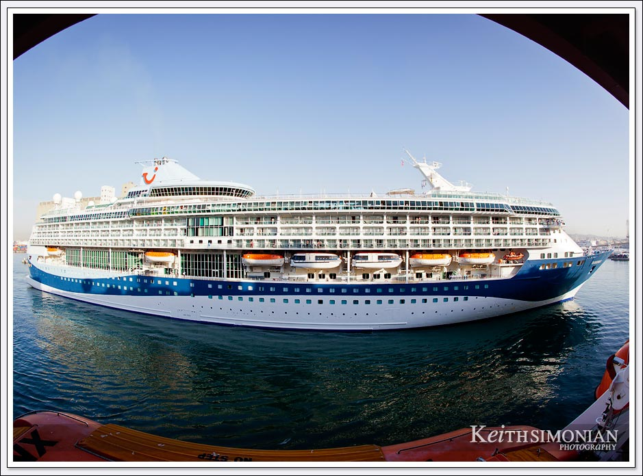 Fisheye view of cruise ship passing by into port - Barcelona Spain