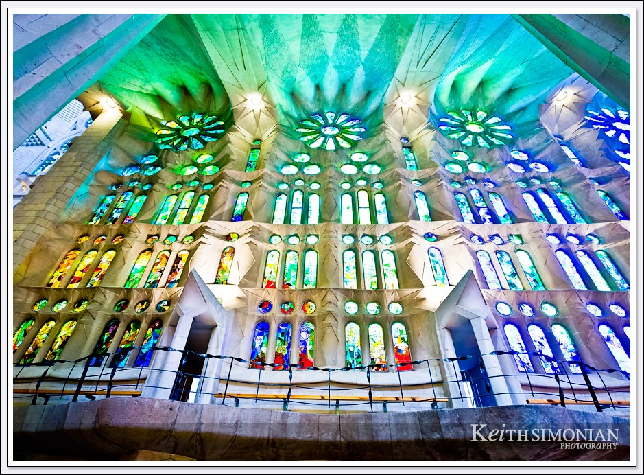 Light streaming through stained glass windows of La Sagrada Familia - Barcelona, Spain