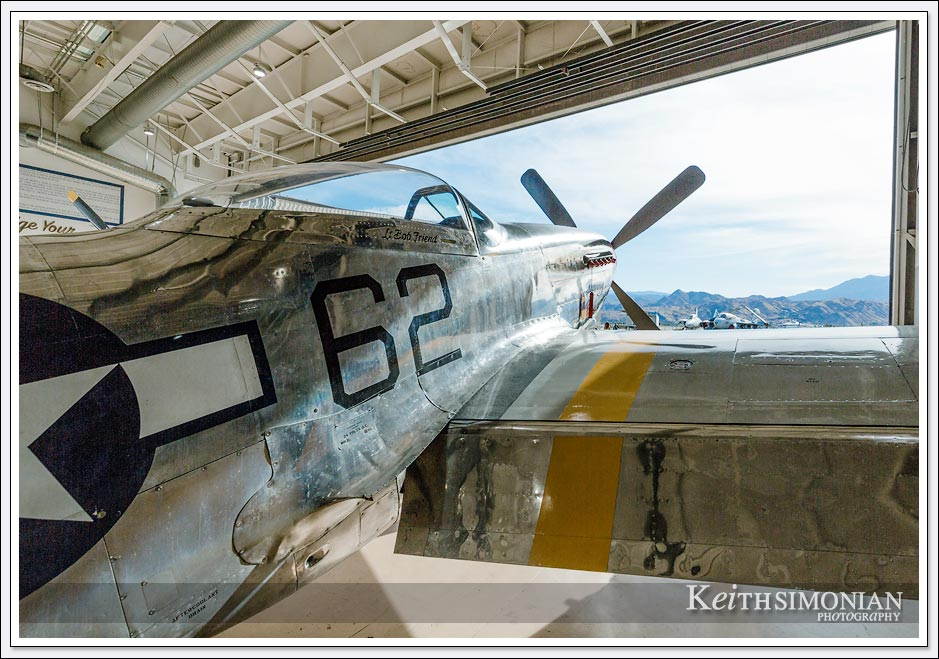 "North American P-51 Mustang ""Bunny"" sits at the edge of the hanger ready to fly - Palm Springs air museum."