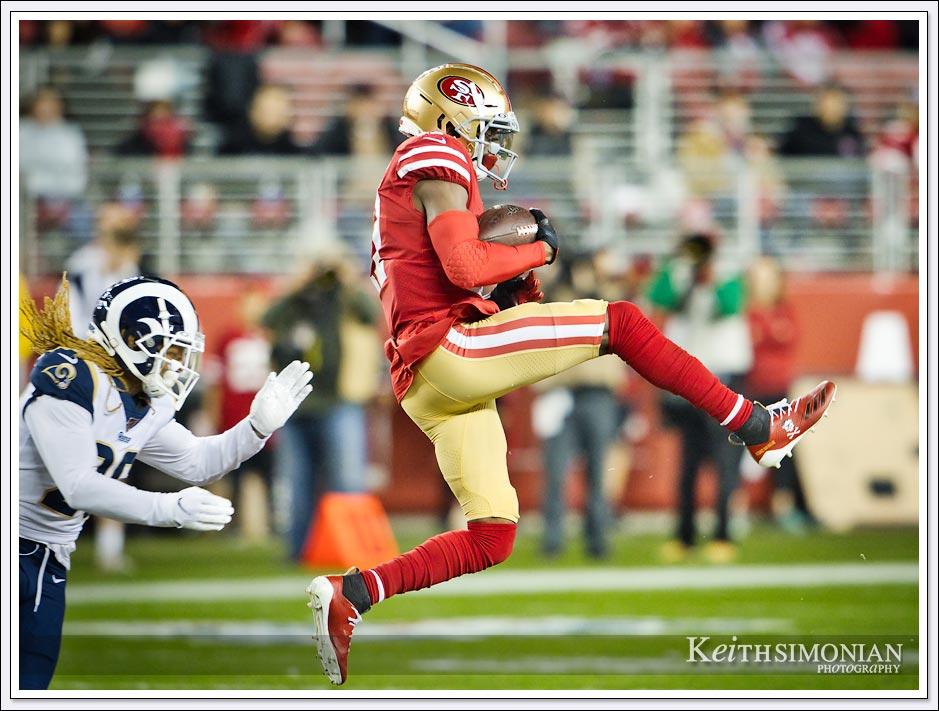 San Francisco 49er #17 Emmanuel Sanders makes a catch against the Los Angeles Rams at Levi's Stadium on December 21, 2019.