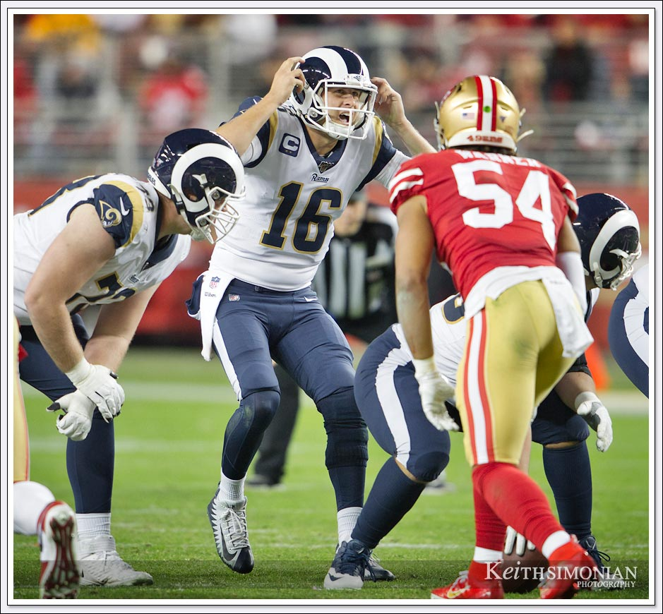 Los Angeles Ram quarterback #16 Jarad Goff calls a play at the line of scrimmage against the San Francisco 49ers at Levi's stadium.