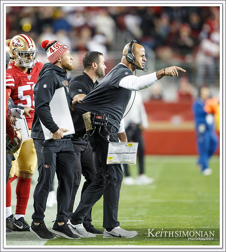 San Francisco 49er Defensive Coordinator Robert Saleh yells onto the field from the sidelines during the game against the Los Angeles Rams on December 21, 2019.