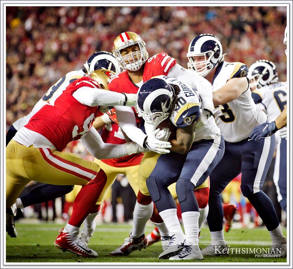 San Francisco 49er #91 Arik Armstead makes a defensive stop against the Los Angeles Rams at Levi's Stadium in Santa Clara on December 21, 2019.