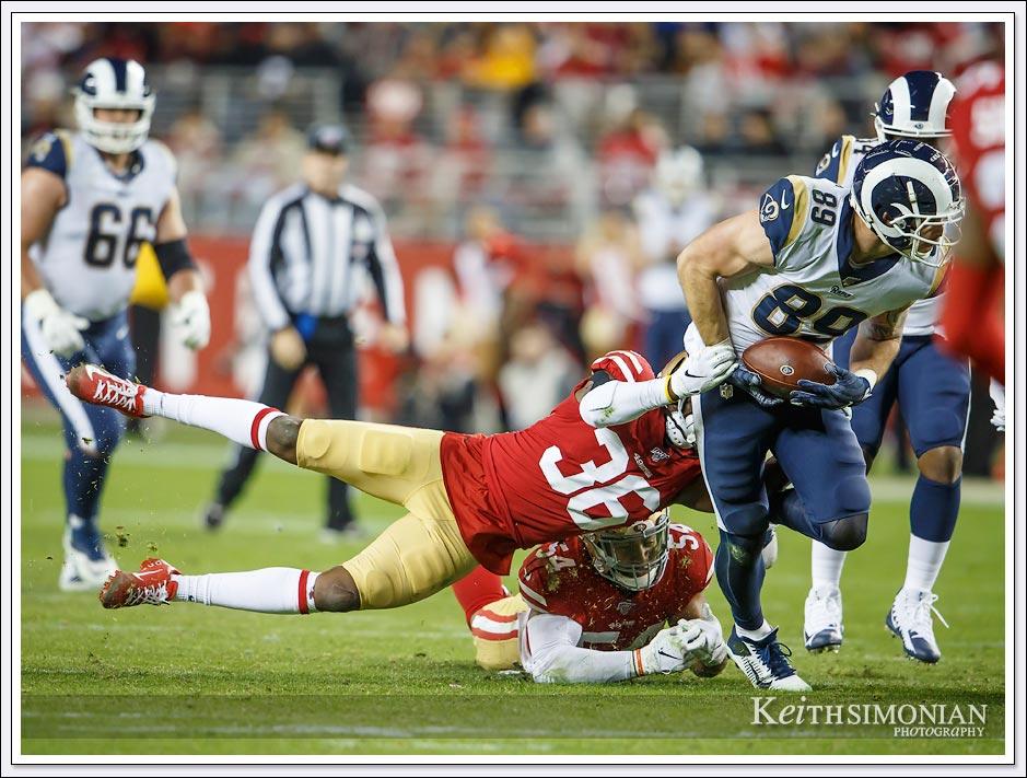 San Francisco 49er #36 Marcell Harris brings down Los Angeles Ram #89 Tyler Higbee.