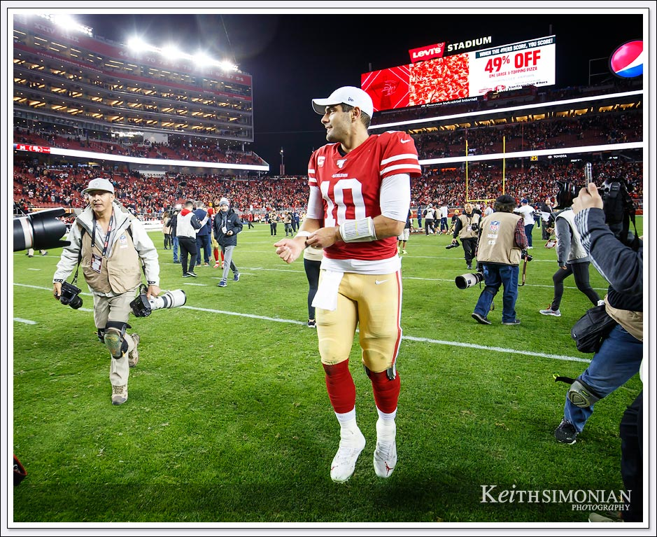 San Francisco 49er quarterback #10 Jimmy Garoppolo walks of the field after the 49ers defeat the Rams at Levi's stadium on December 21, 2019.