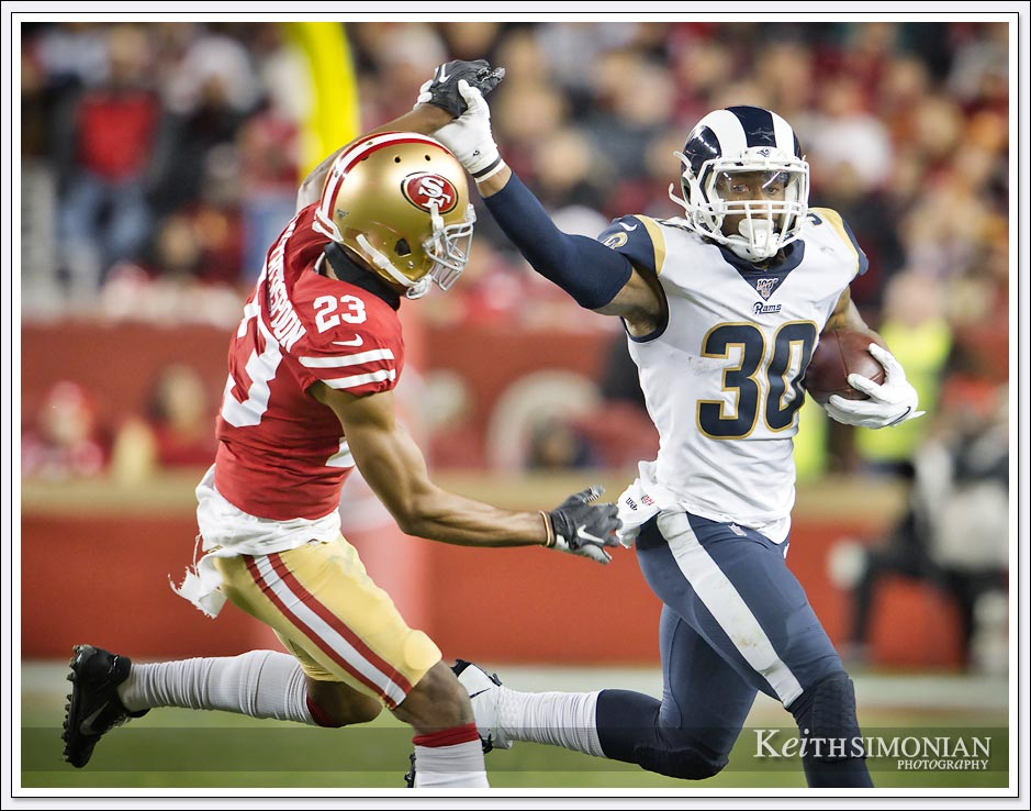 Los Angeles Rams half back #30 Todd Gurley II tries to break free for extra yards against San Francisco 49ers in Levi's Stadium on December 21, 2019.