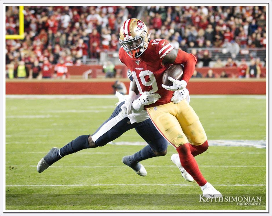 San Francisco 49er #19 Debbo Samuel makes a catch against the Los Angeles Rams on December 21, 2019 in Levi's Stadium in Santa Clara.