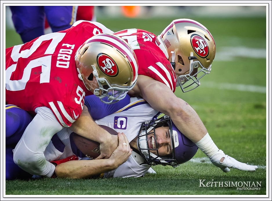 Minnesota Vikings quarterback Kirk Cousins is sacked by the San Francisco 49ers.