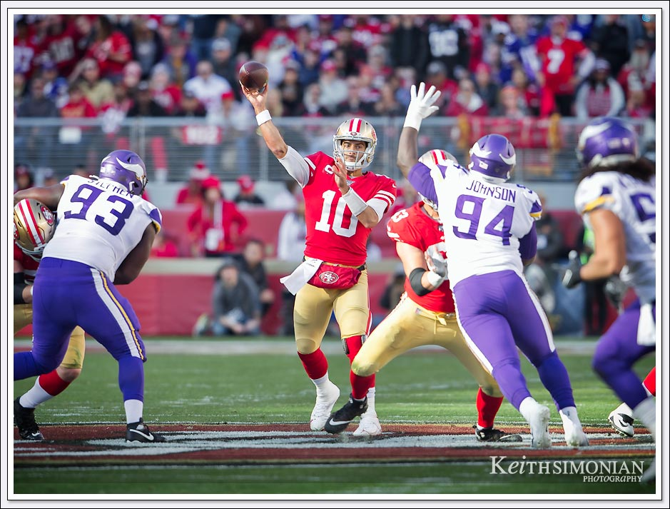 San Francisco 49er quarterback 10 Jimmy Garoppolo throws down field against the Minnesota Vikings.