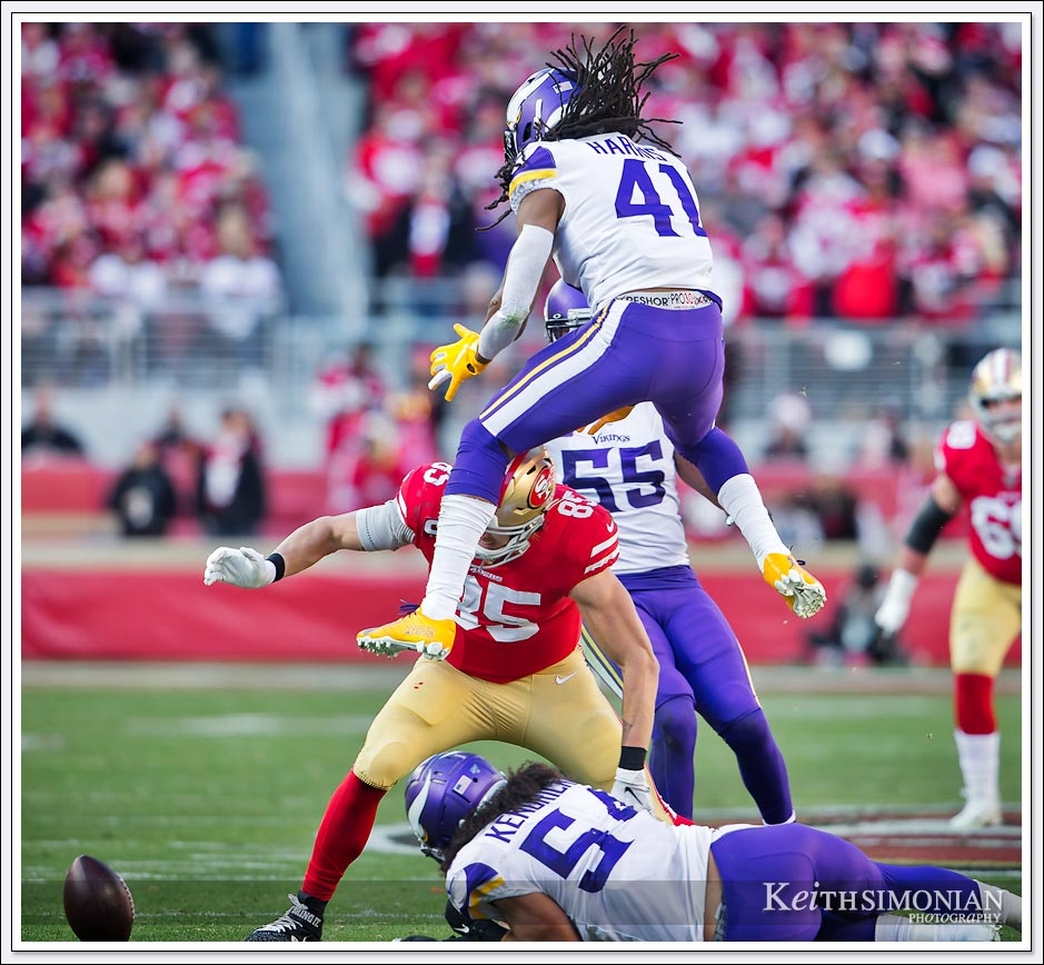 Minnesota Viking #41 Anthony Harris leaps in the air to prevent a pass reception by the 49ers during the Divisional Playoff game at Levi's Stadium in Santa Clara, California