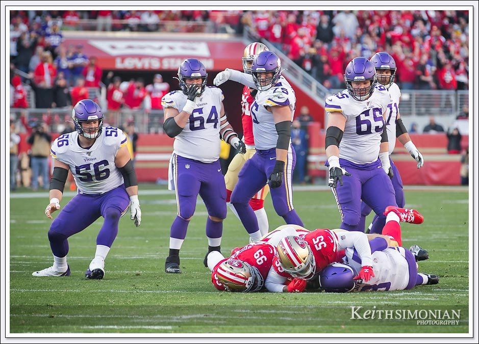Five Minnesota Vikings offensive lineman watch as #99 DeForest Buckner and #55 Dee Ford sack quarterback Kirk Cousins in the Divisional playoff round on January 11th, 2020 at Levi's Stadium.