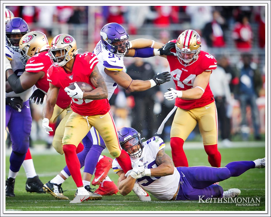 San Francisco 49er running back #31 Raheem Mostert tries to escape the grasp of Vikings Linebacker #50 Eric Wilson - January 11th, 2020 - Levi's Stadium Santa Clara, CA.