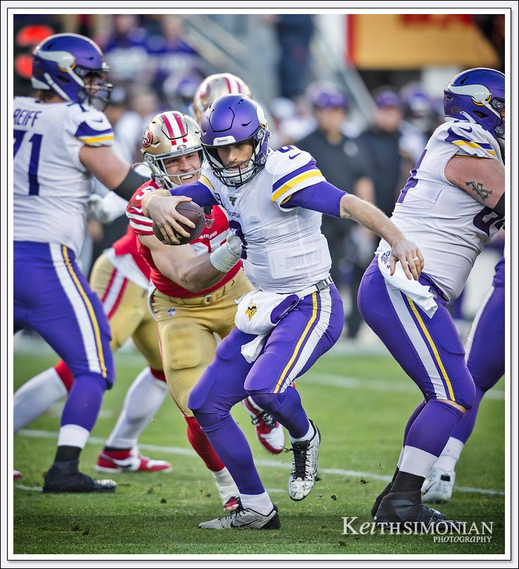 San Francisco 49er #97 Nick Bosa grabs the jersey of Minnesota Vikings quarterback Kirk Cousin during the Divisional playoff game at Levi's Stadium in Santa Clara, CA.