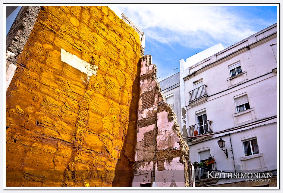 Yellow and white walls in the city of Cadiz Spain.