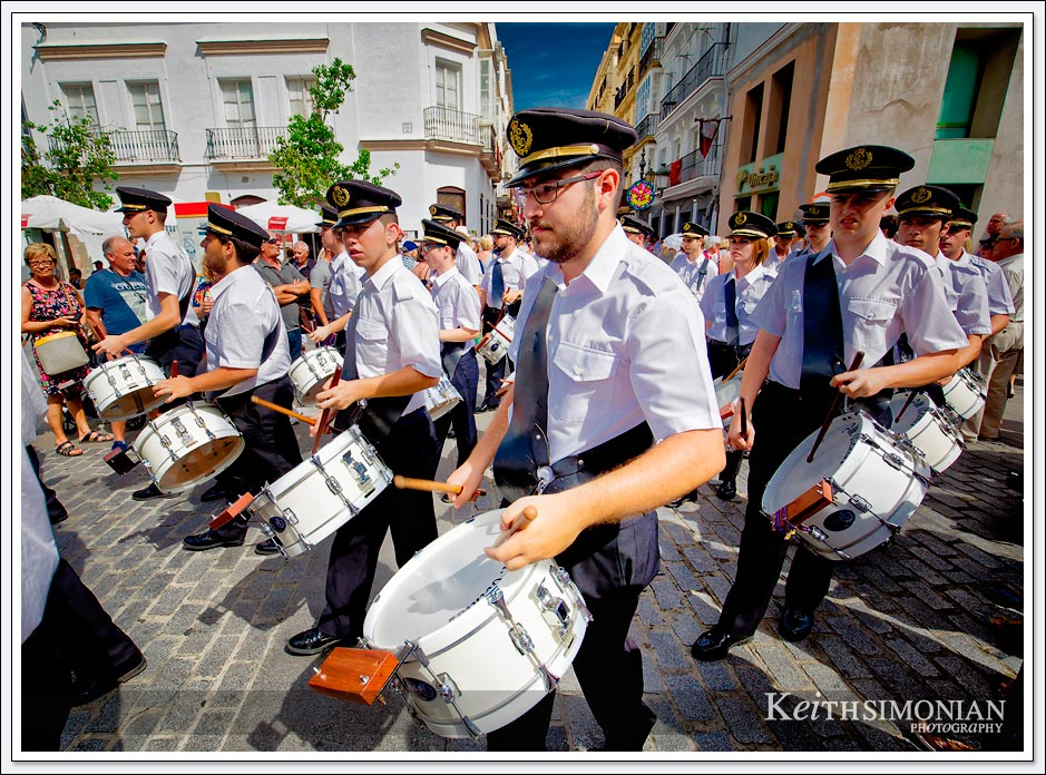 The drum core marches during the Corpus Christi Festival in Cadiz Spain.