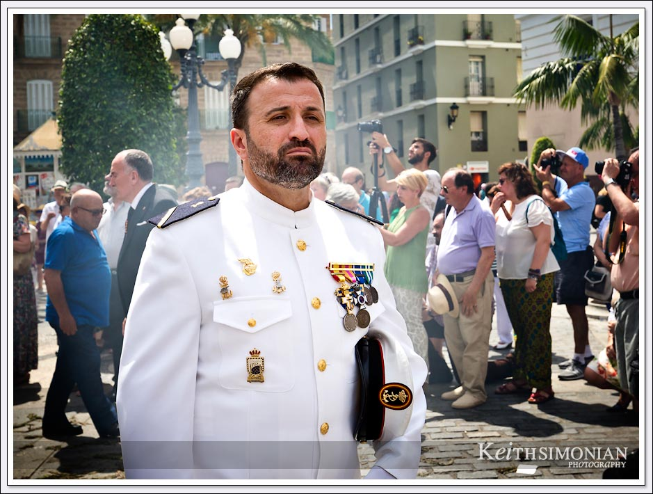 Corpus Christi Festival in which this gentlemen is wearing his white uniform and medals - Cadiz, Spain.