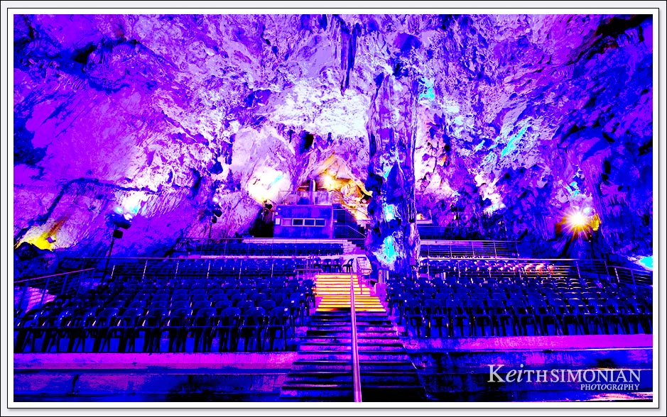 Purple lights color the seating inside the caves of the Rock of Gibraltar.