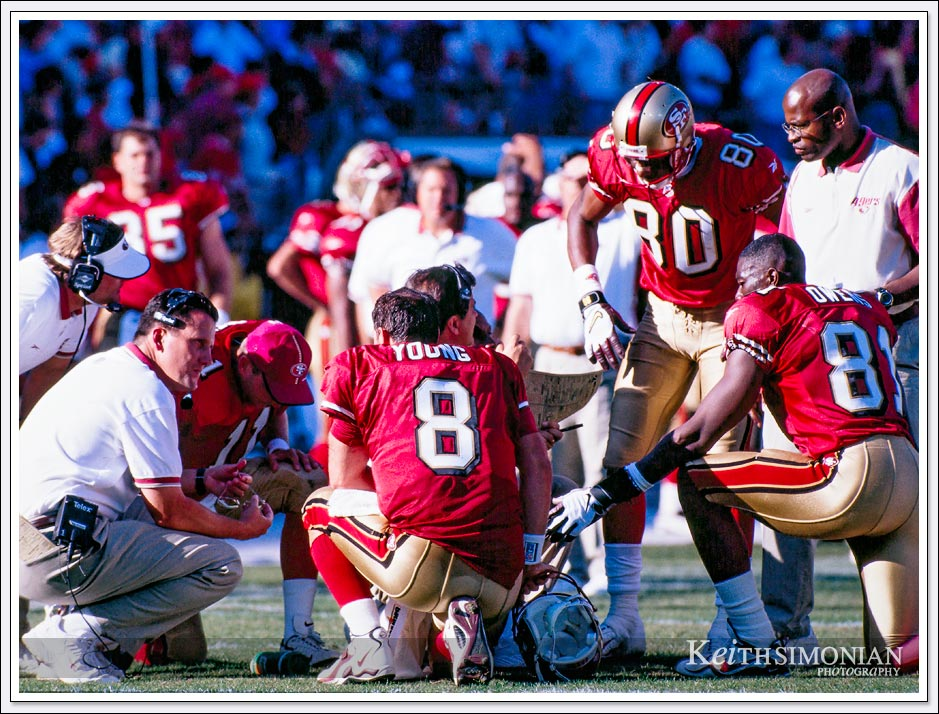 This discussion during time out to discuss the next play includes three San Francisco 49ers who will enter the NFL Hall of Fame. Steve Young, Jerry Rice, and Terrell Owens ( TO ).