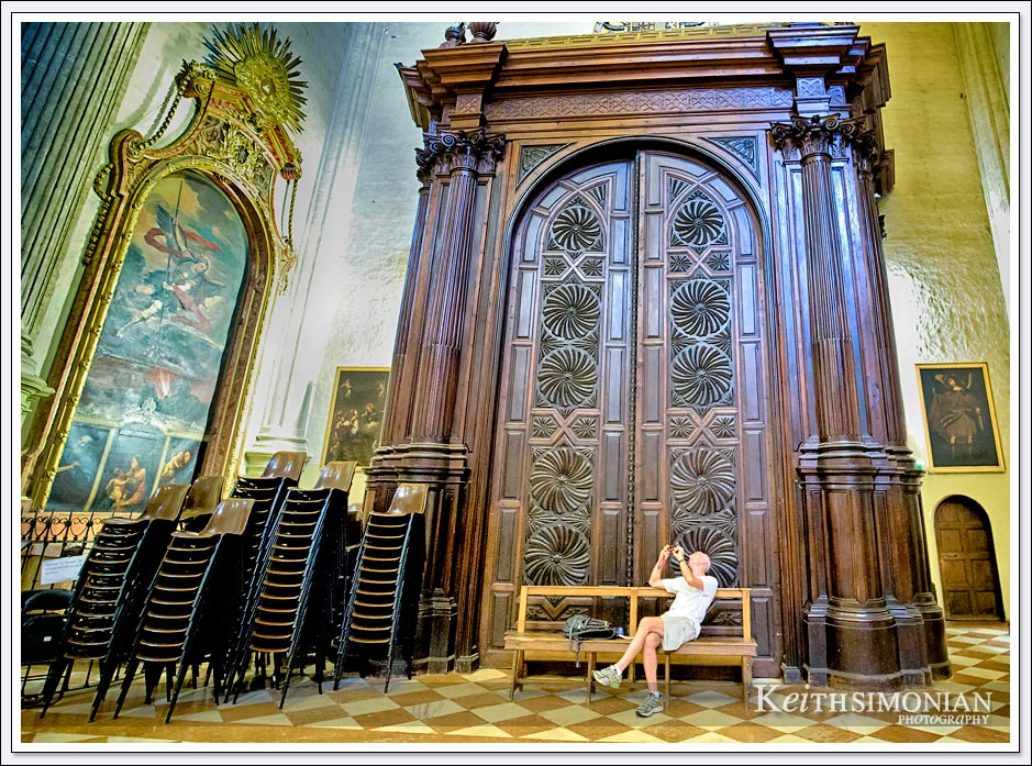 Visitor taking photo inside the Malaga Cathedral in Malaga Spain.