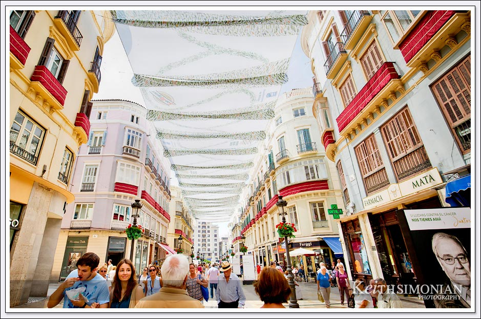 Shoppers walking along La Calle Larios - Malaga, Spain. Europe