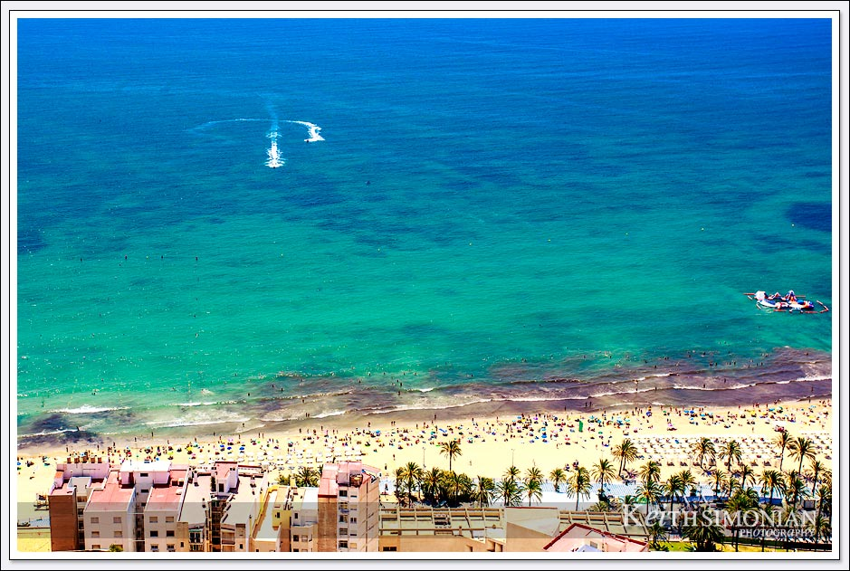 Blue and Green waters of Playa del Postiguet - Alicante Spain.