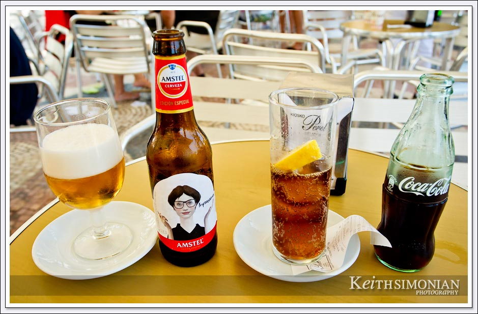 Amstel beer and Coca Cola on outside table in Alicante Spain