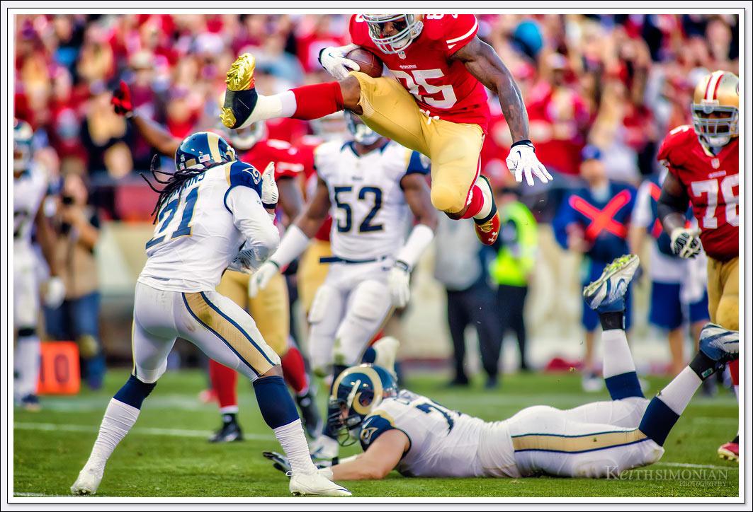 San Francisco 49er Tight end #85 Vernon Davis hurdles over St. Louis Ram cornerback #21 Janoris Jenkins for a touchdown - Candlestick Park - San Francisco