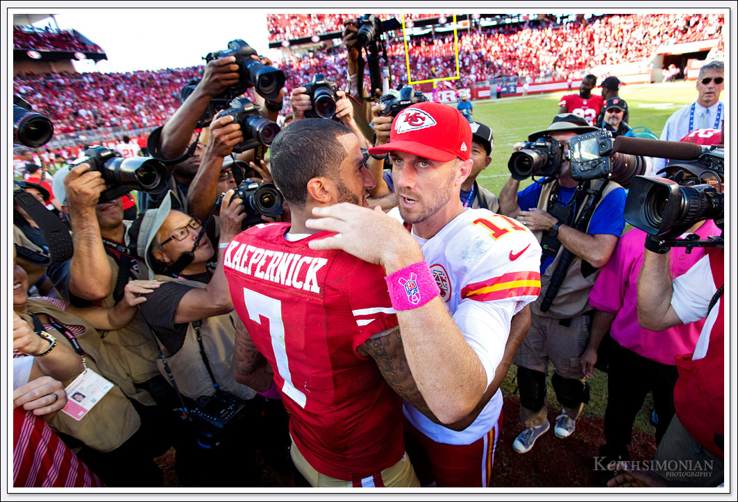 Alex Smith and Colin Kaepernick meet after the Kansas City Chiefs and San Francisco 49ers play at Levi's stadium.