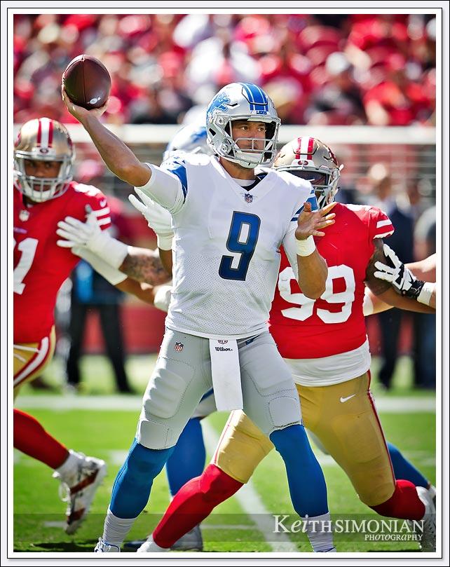 Detroit Lions quarterback #9 Matthew Stafford releases his pass just before 49er defenders make a sack - Levi's Stadium - Santa Clara, CA