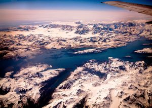 Snow covered mountains of Alaska viewed from 39,000 feet.