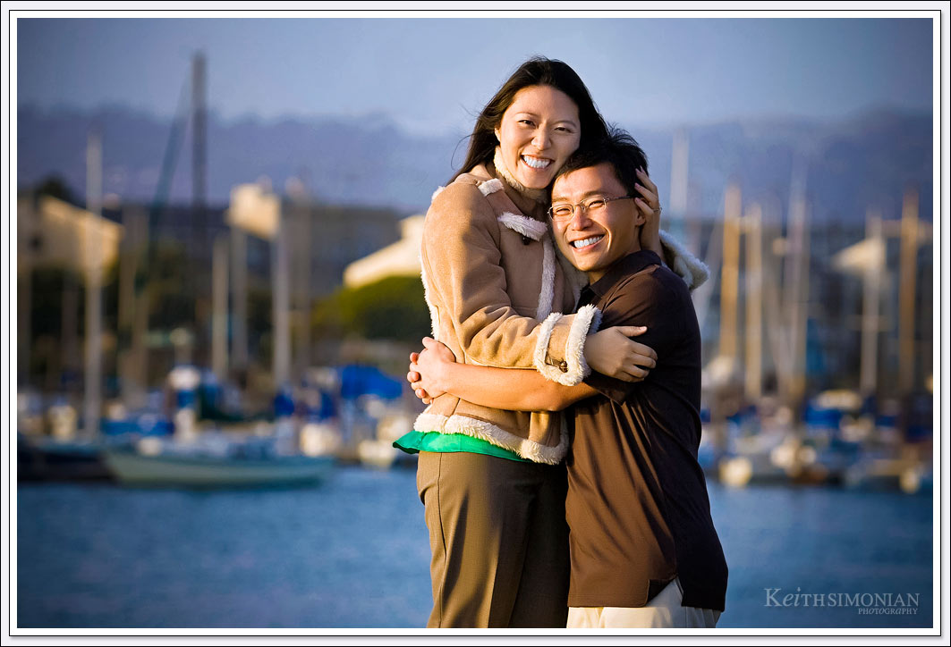 The many sail boats tied up at the Oakland Marina serve as splendid backdrop for Engagement photos in Oakland, California