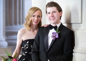 Both the bride and groom were decked out in black for their San Francisco city hall wedding.