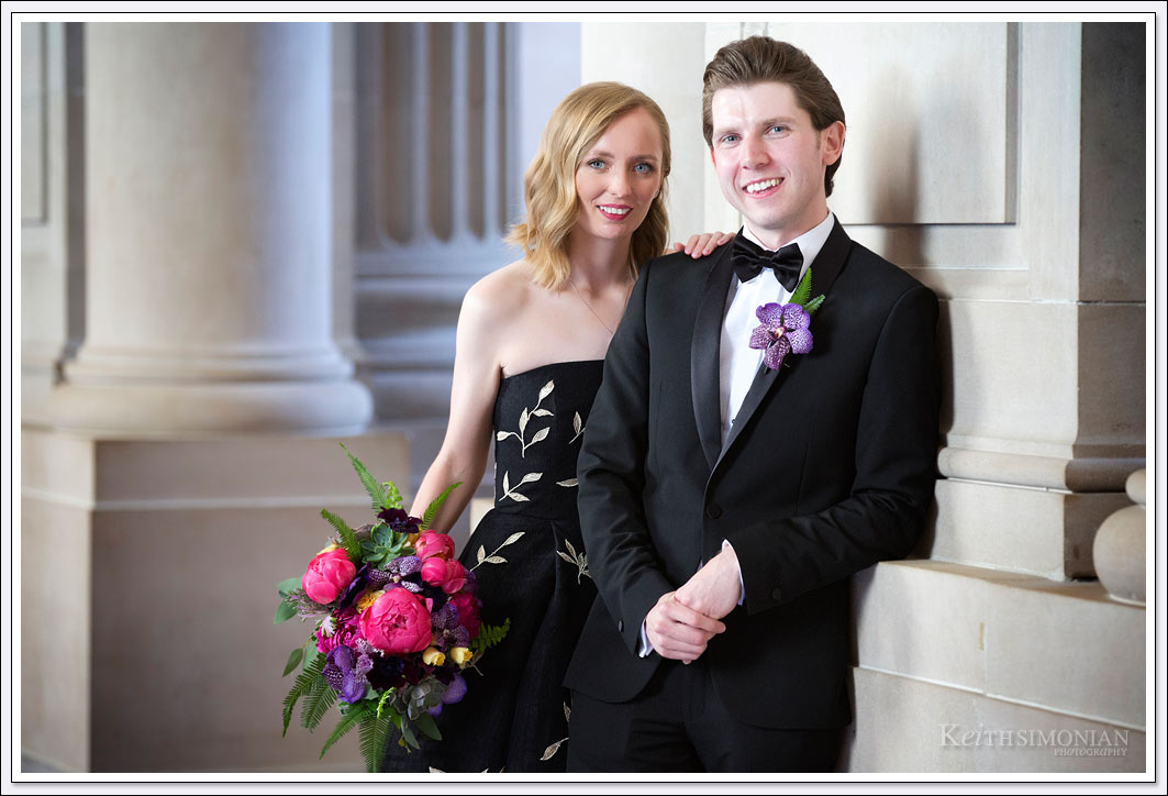 Both the bride and groom were decked out in black with bride in a black dress and the groom in a black tuxedo for the San Francisco city hall wedding.