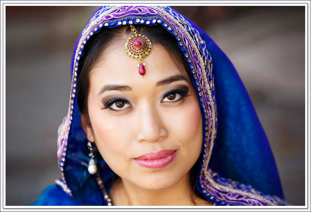 This South Asian bride is wearing a blue veil
