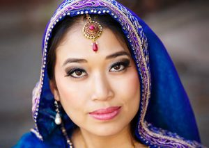 For this portrait the bride is wearing a purple veil.