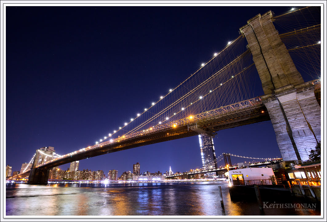 The nighttime reflections in the East River make this photo of the Brooklyn Bridge almost twinkle.