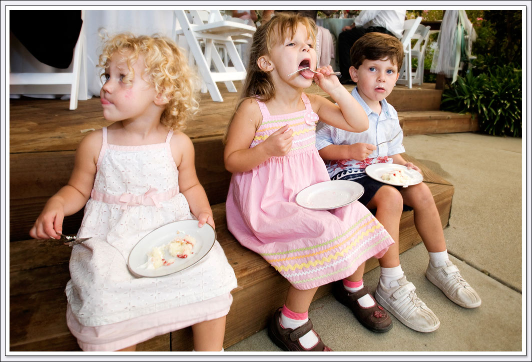 Candid photography of children enjoying their cake at the wedding reception