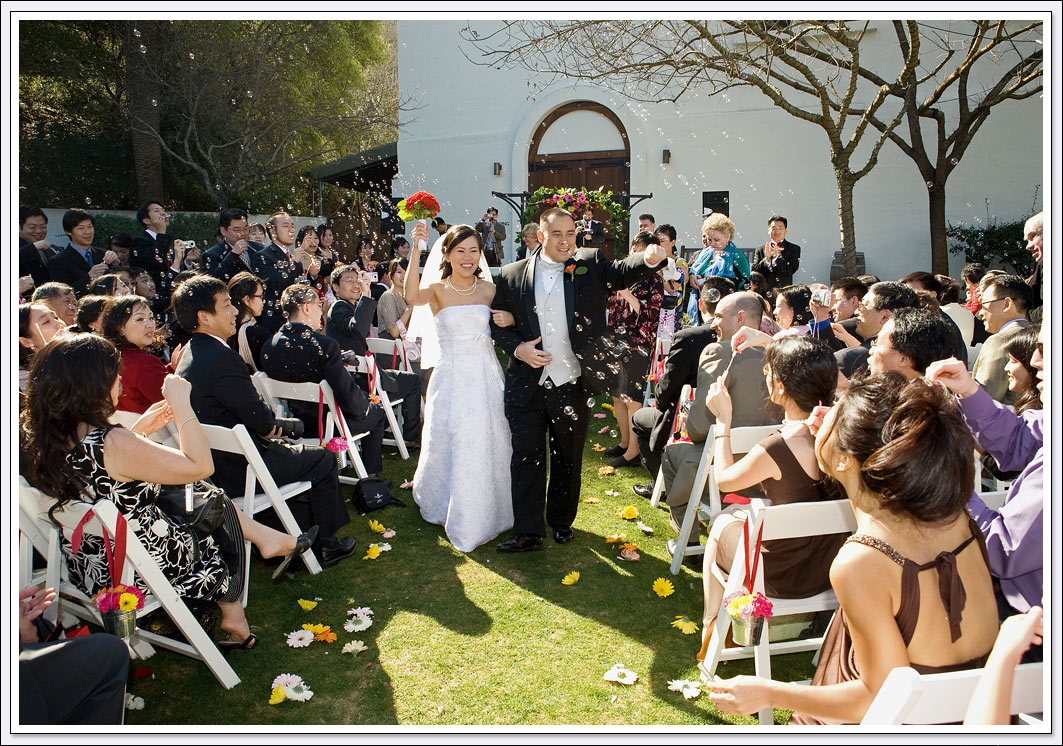 Bubbles greet the bride and groom as they walk down the aisle at Wente Vineyards