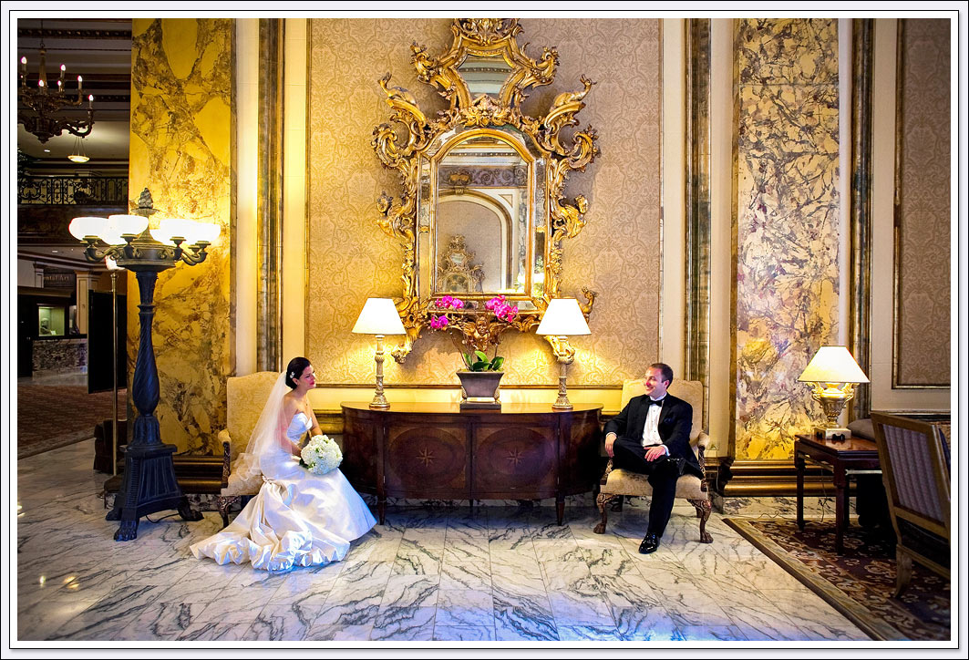 The world renowned Fairmont hotel lobby provides a stunning backdrop for wedding photos of the bride and groom in San Francisco, California.