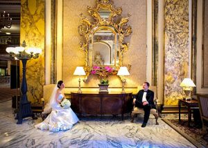 Bride and Groom in the elegant lobby of the Fairmont Hotel - San Francisco, CA