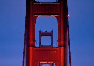 Car lights during rush hour traffic on the Golden Gate Bridge.