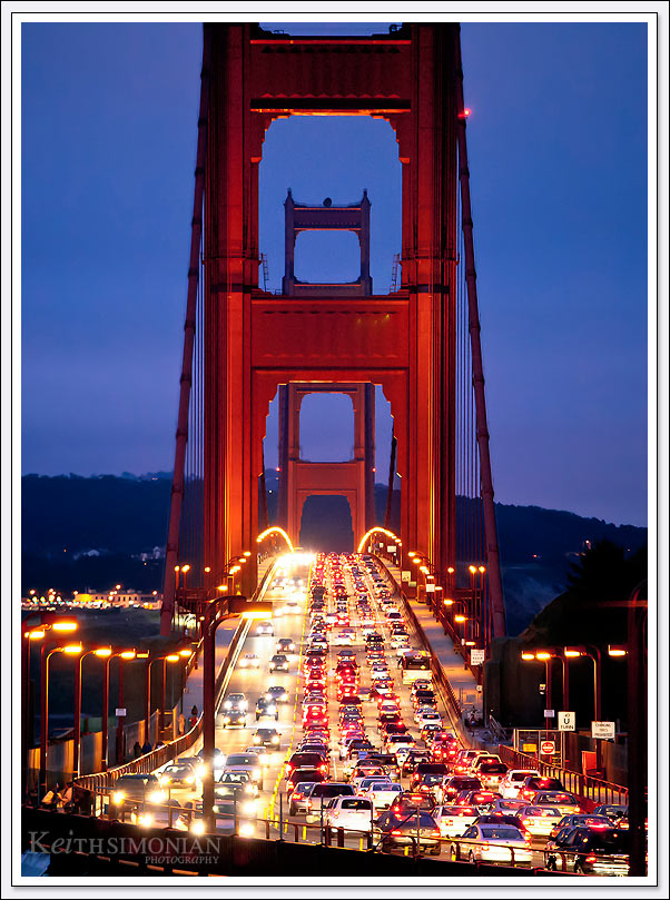Hand held image of Golden Gate bridge rush hour traffic at twilight from the Marin side of the bridge.